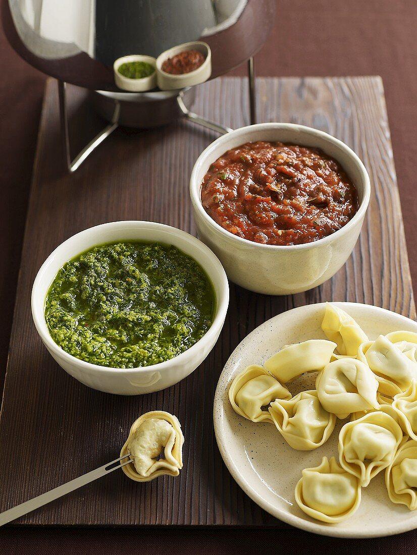 Fondue with tortellini and pesto