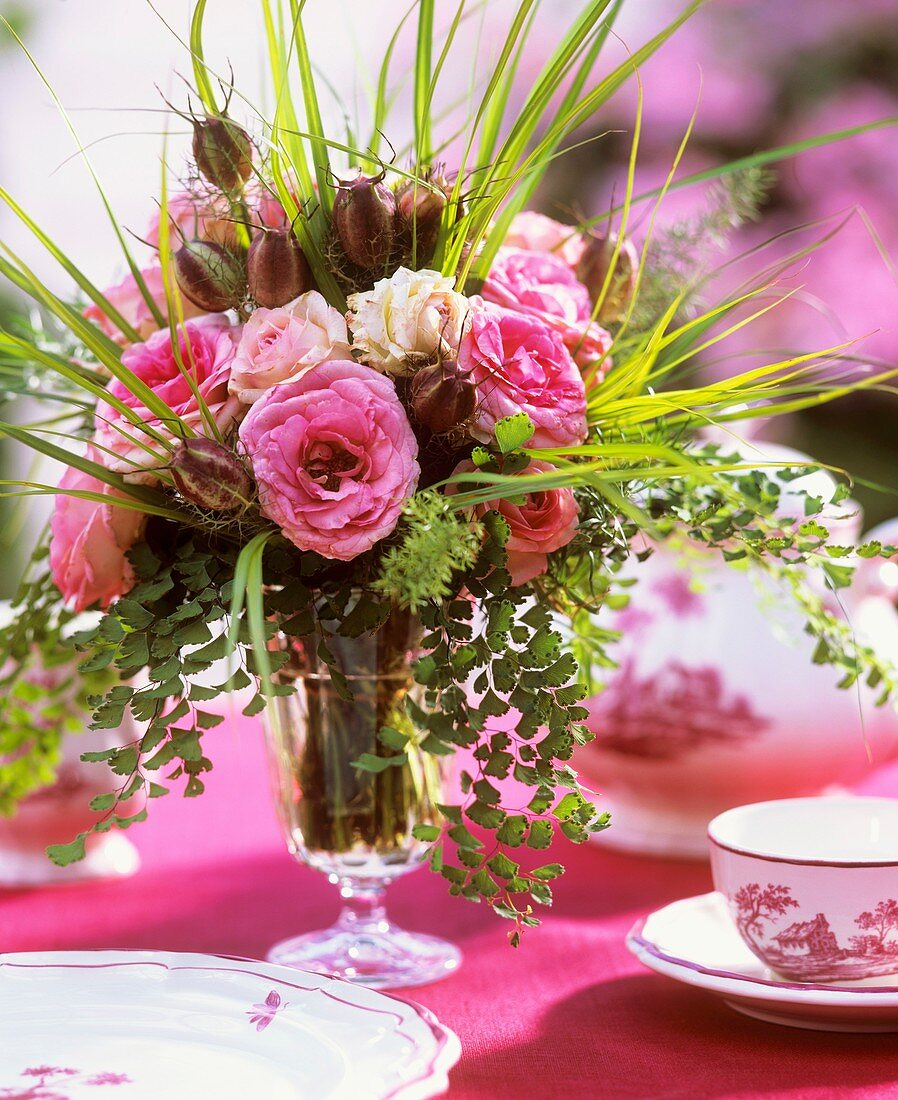 Arrangement of roses with grasses and Nigella seed pods