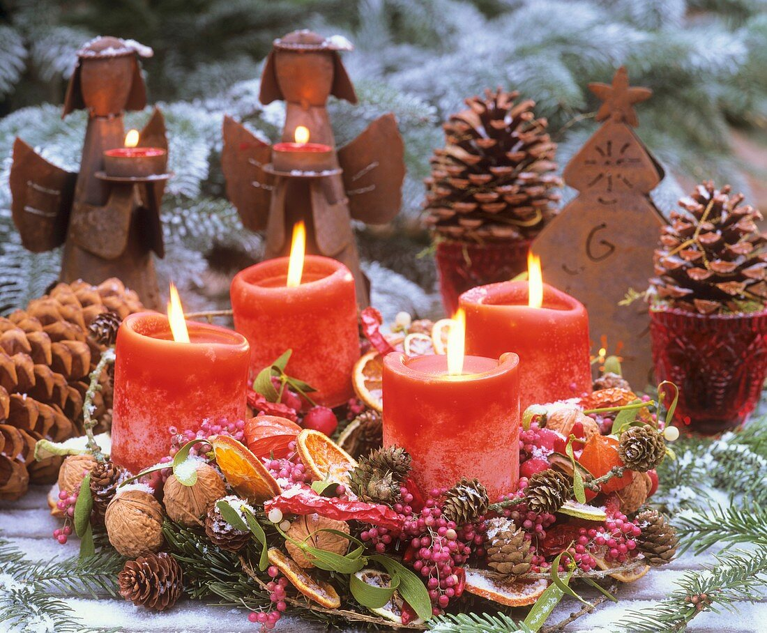 Advent wreath with pink pepper in snow