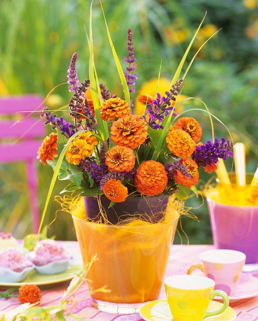 Summery arrangement of Zinnias and sage