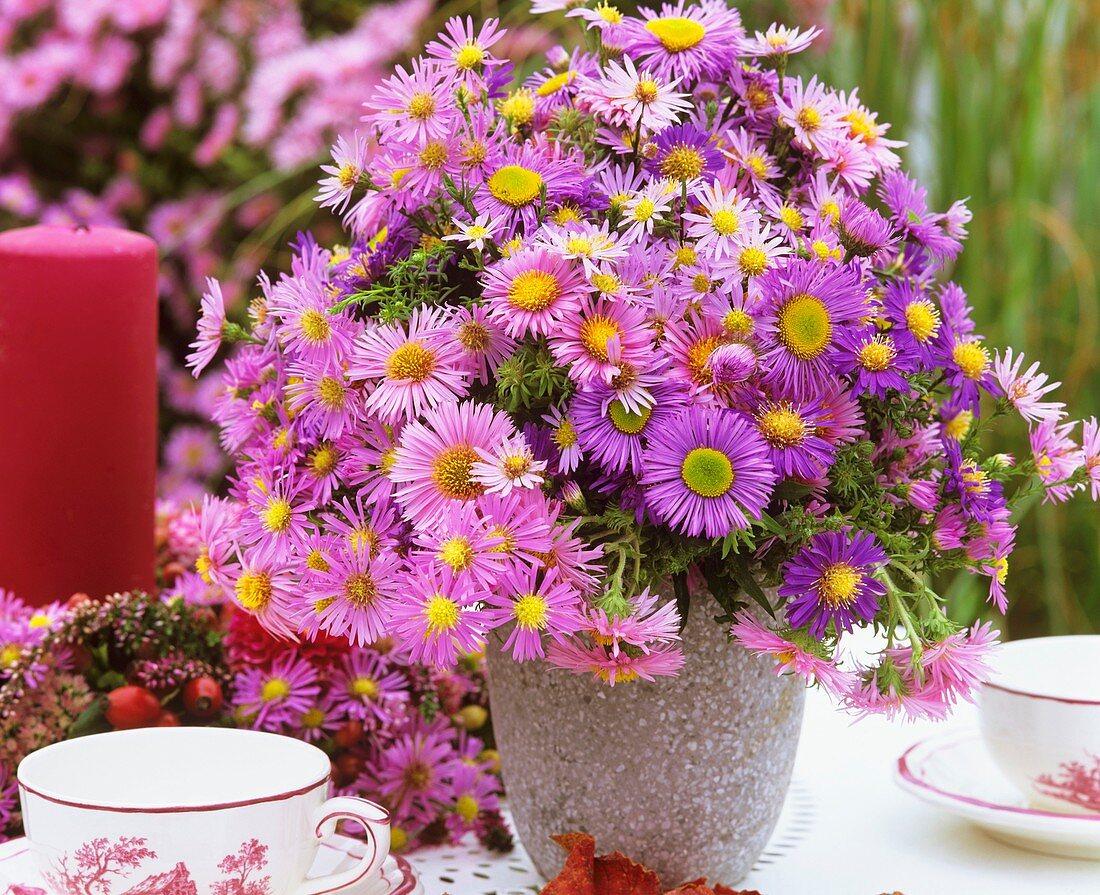 Vase of Michaelmas daisies