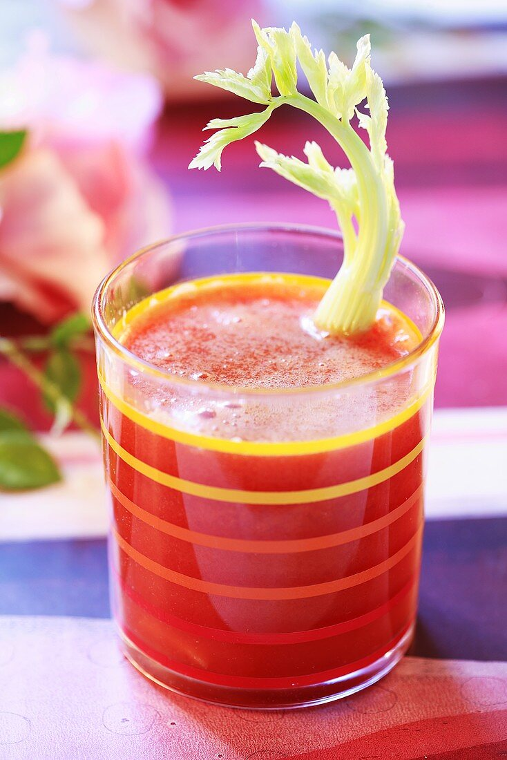 Vegetable drink with stick of celery