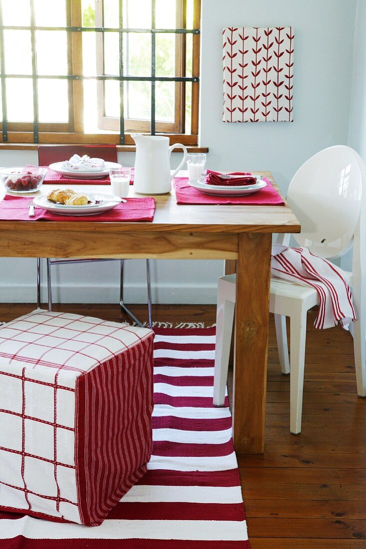 A dining table laid in red and white