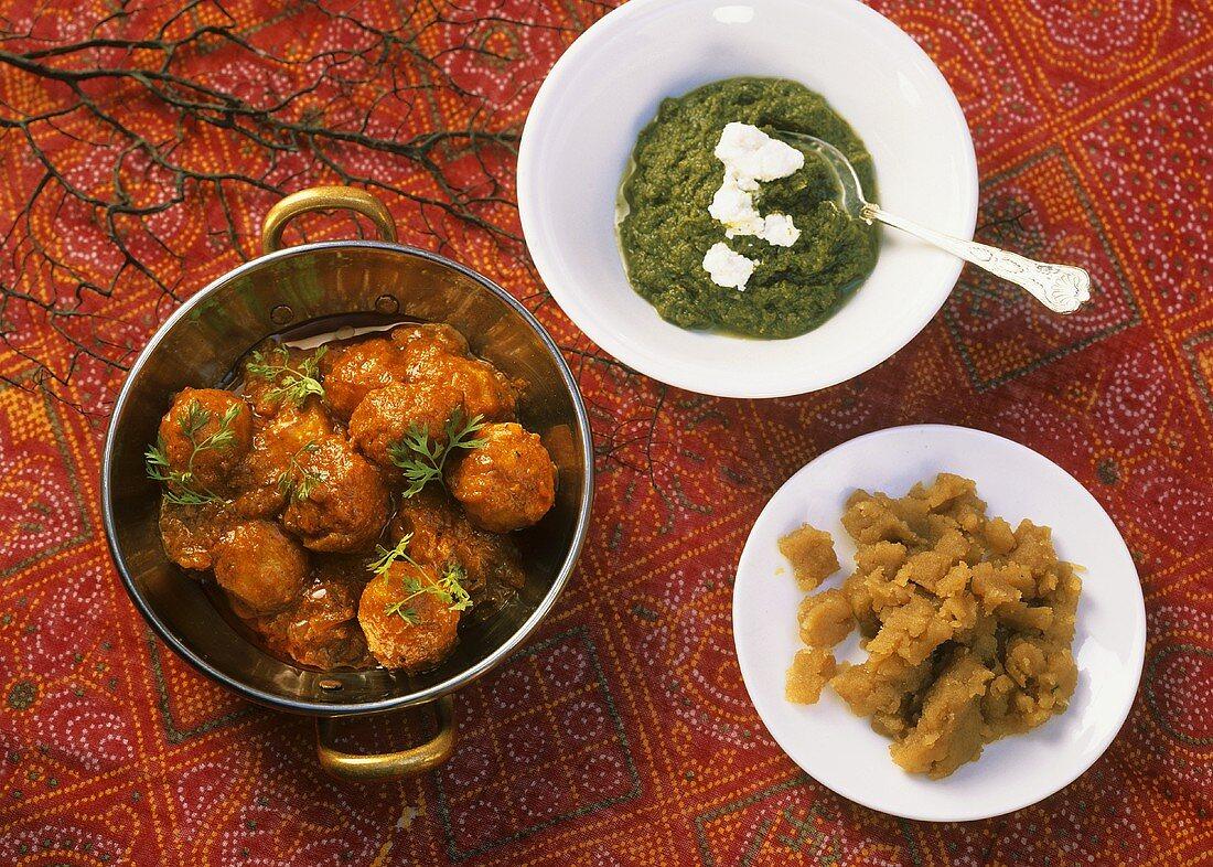 Sarson ka saag (Indian mustard greens) and meatballs