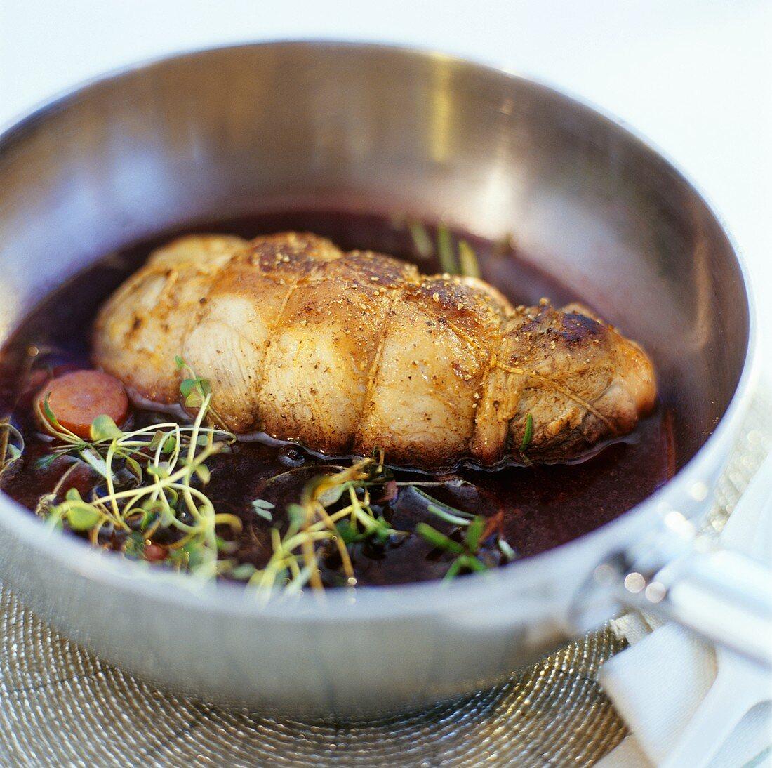 Rolled wild boar roast in red wine sauce