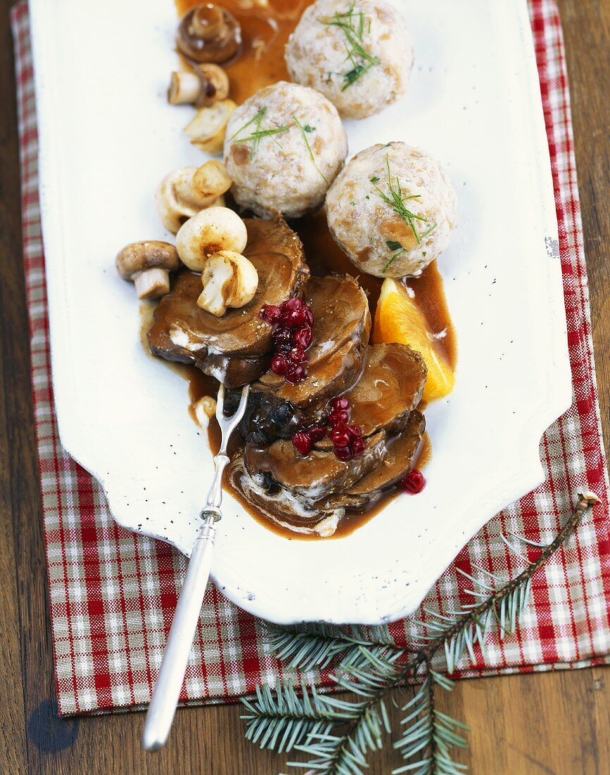 Roast venison with fig dumplings