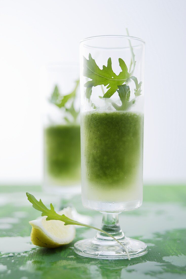 Two glasses of gin cocktail with rocket