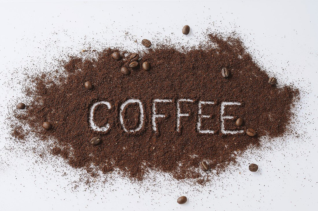 The word COFFEE written in ground coffee