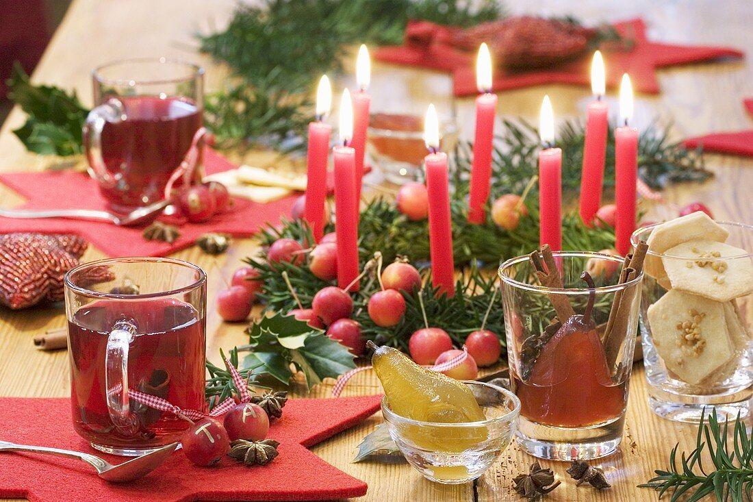 Christmas table with wreath, grog and biscuits