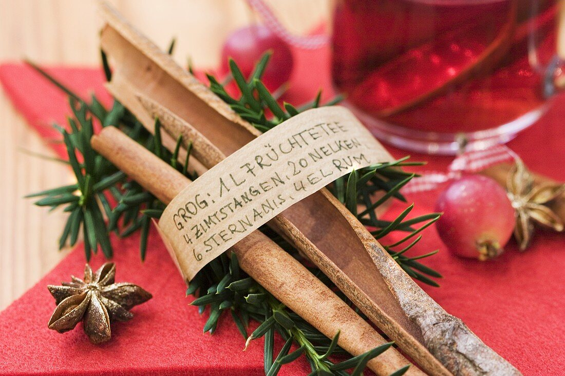 Cinnamon sticks with list of ingredients for grog (rum toddy)