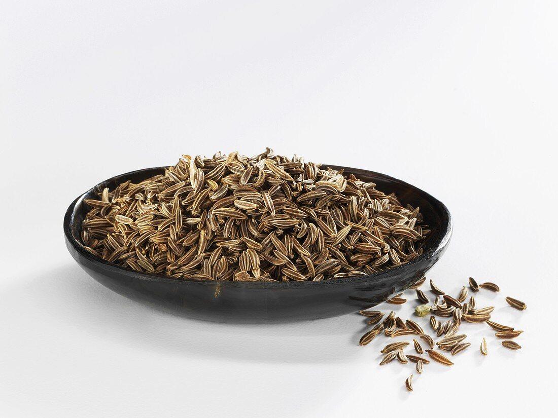 Caraway seed in a black dish