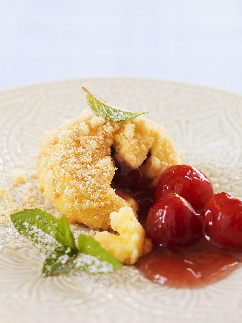 Semolina dumpling with cherries