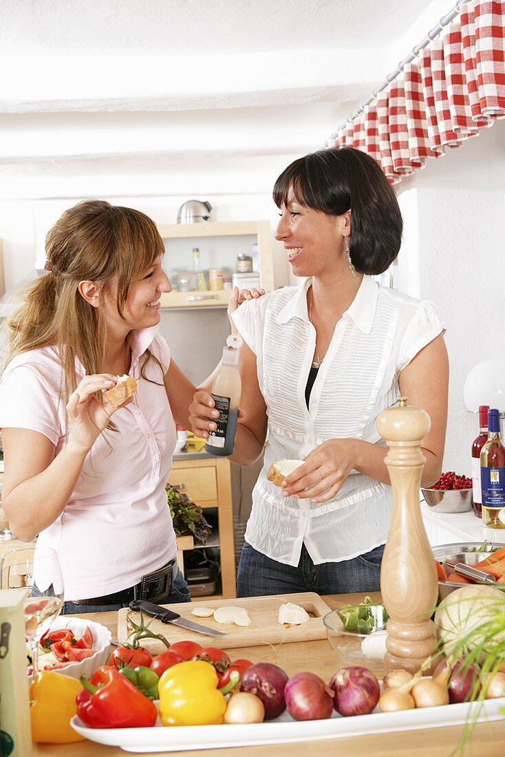 Friends chatting while cooking