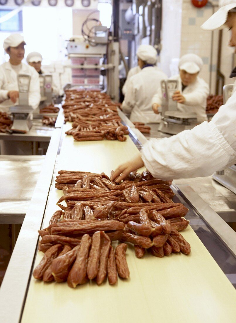 Workers in a Chinese sausage factory
