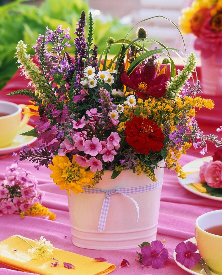 Posy of summer flowers on tea table