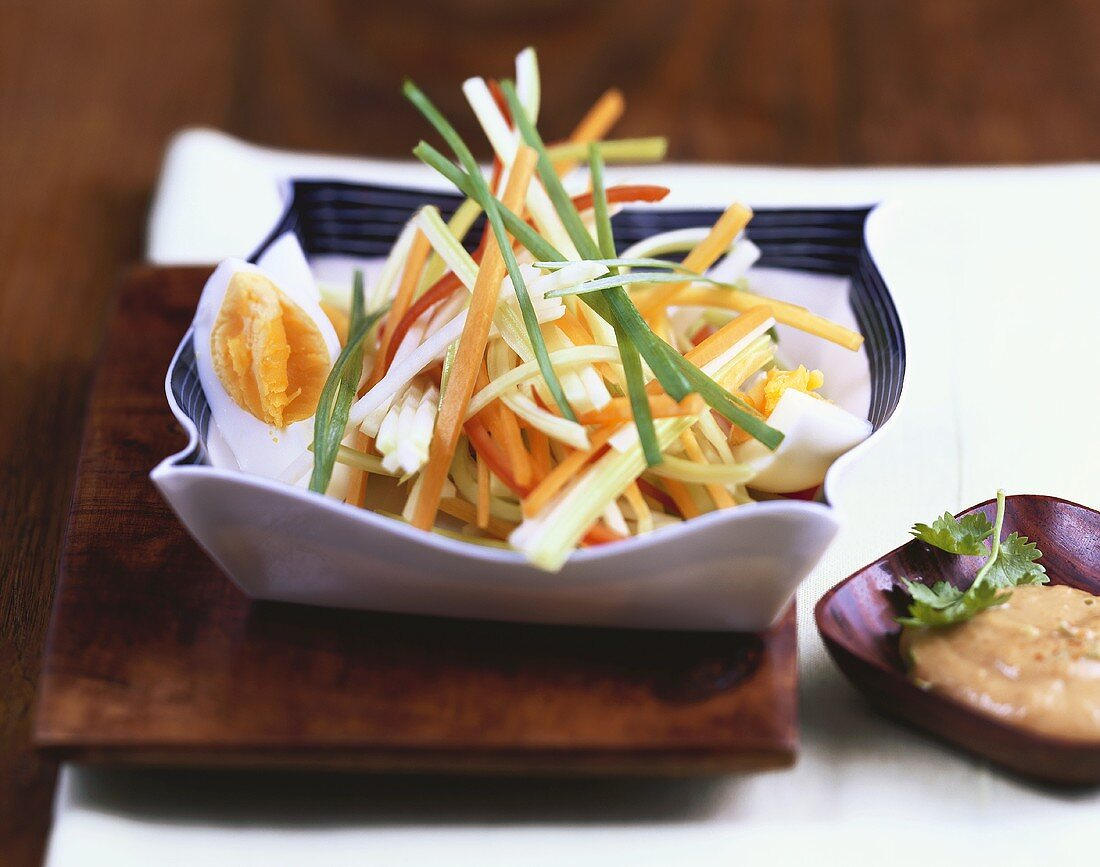 Indonesian salad with egg and peanut dip