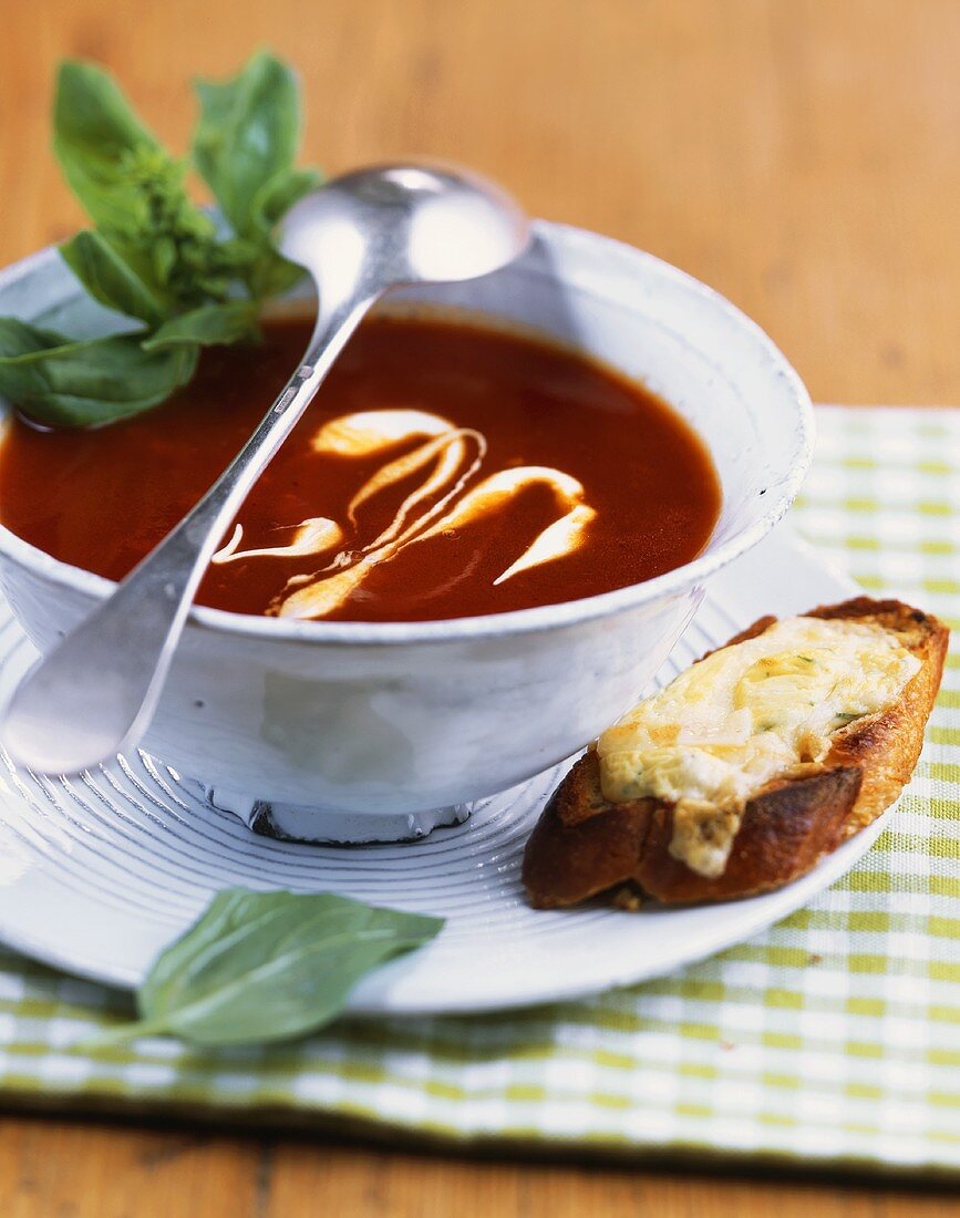 Tomato and orange soup with toasted quark on baguette