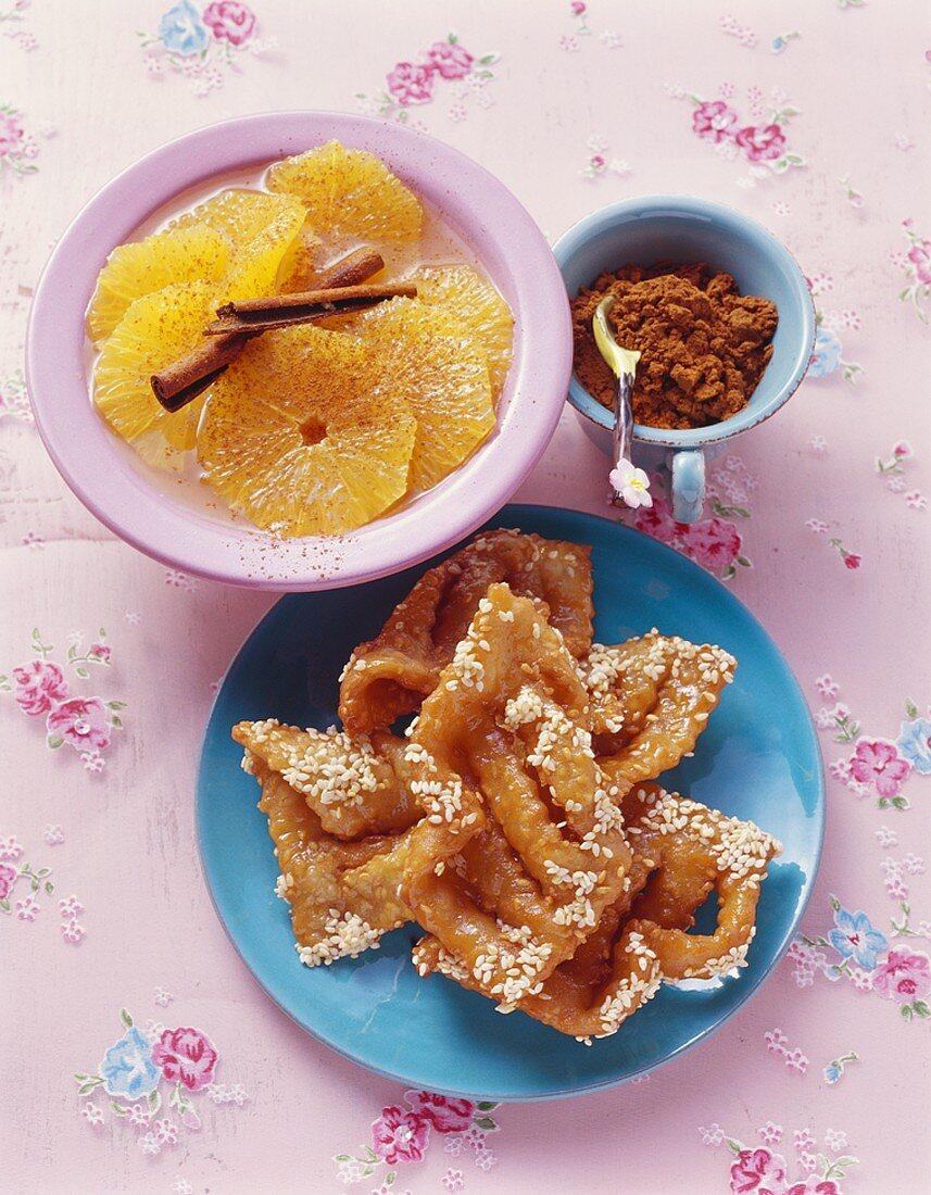 Moroccan honey cakes and orange salad with cinnamon sticks