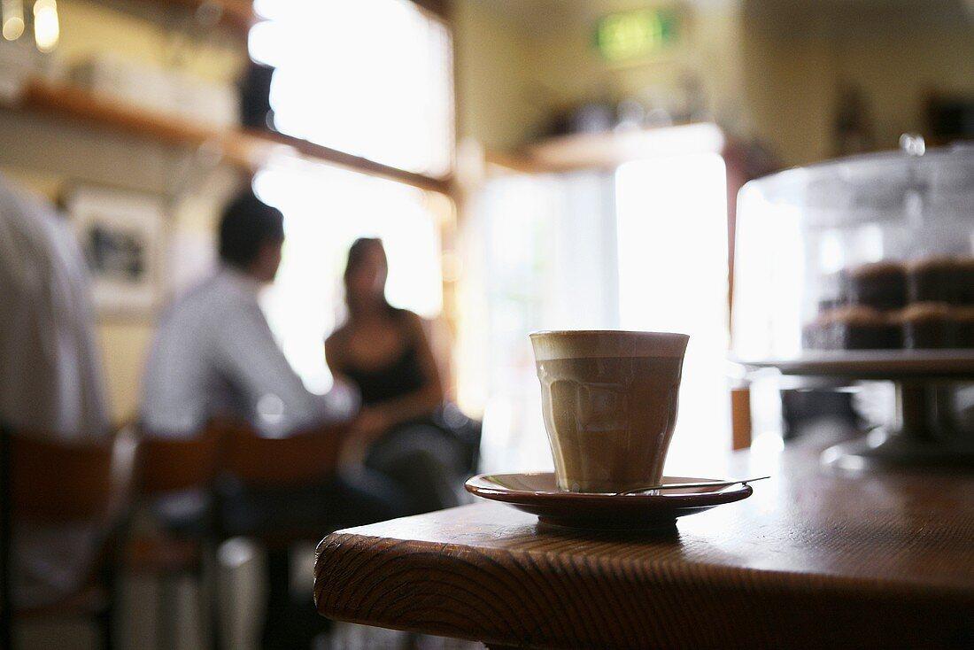 Caffè latte on counter in cafe