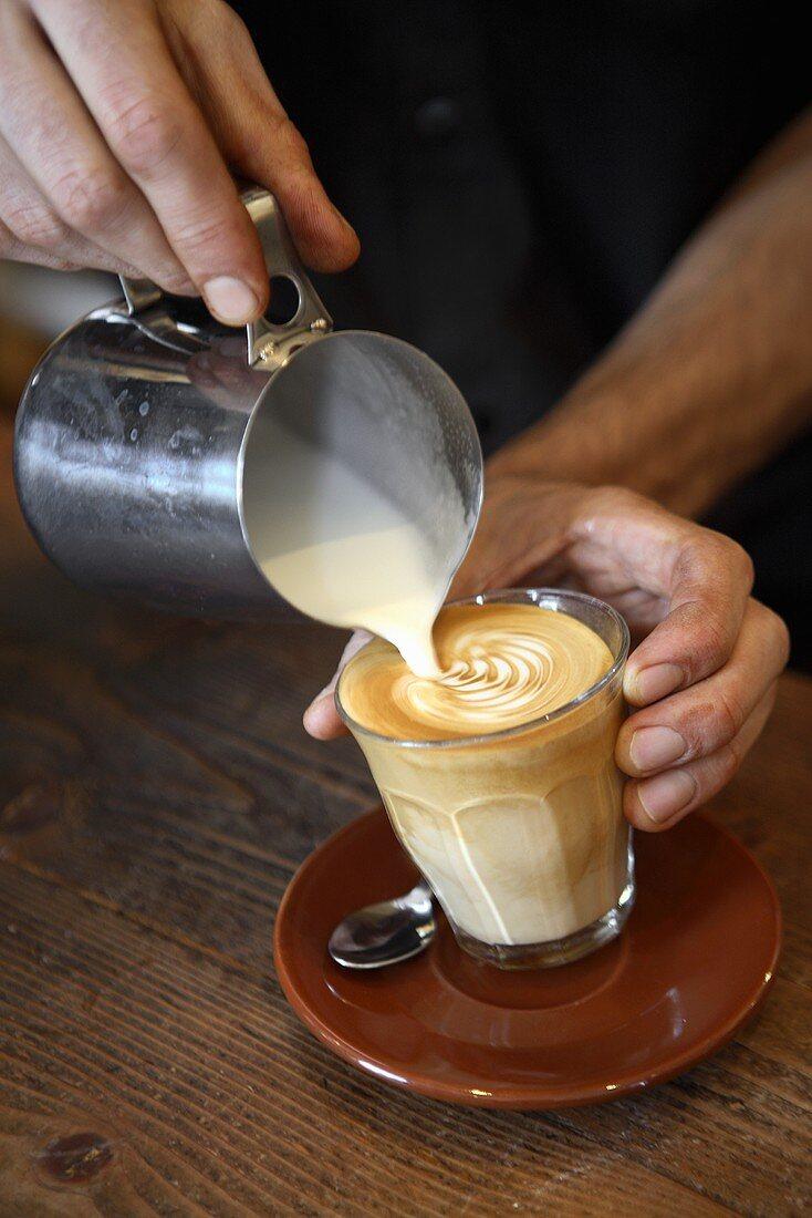 Barista making caffè latte