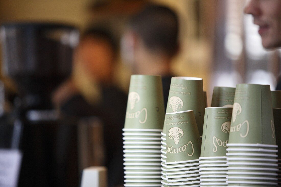 Stacked paper cups in a cafe