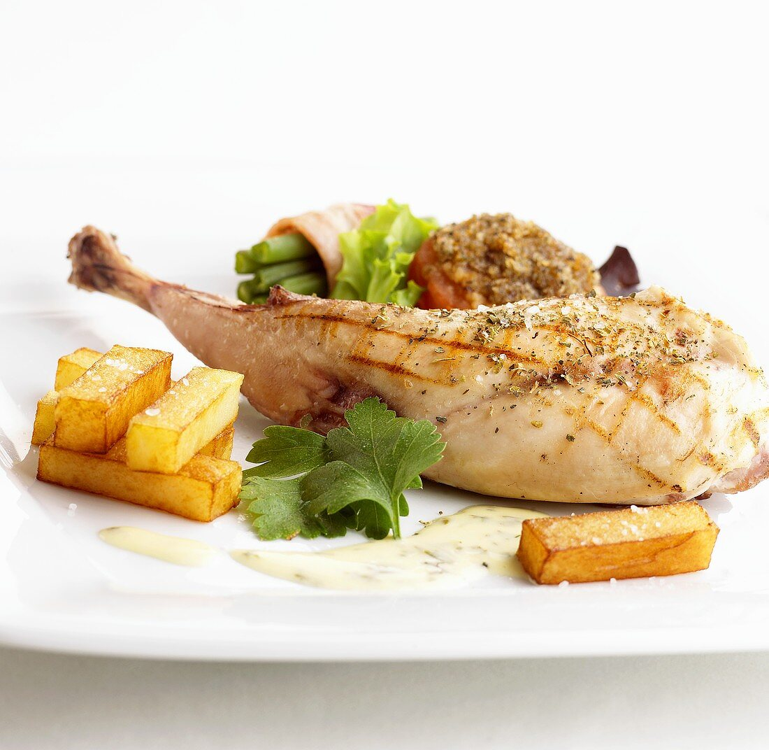 Grilled rabbit leg with accompaniments