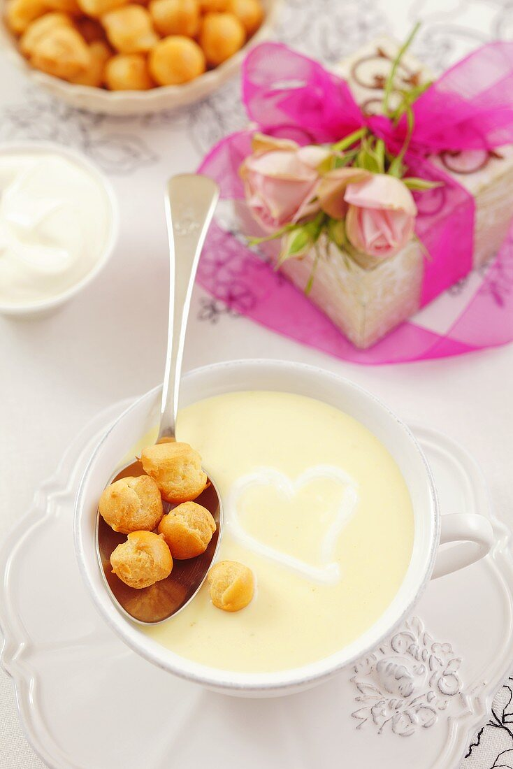 Cream of cheese soup with soup pearls