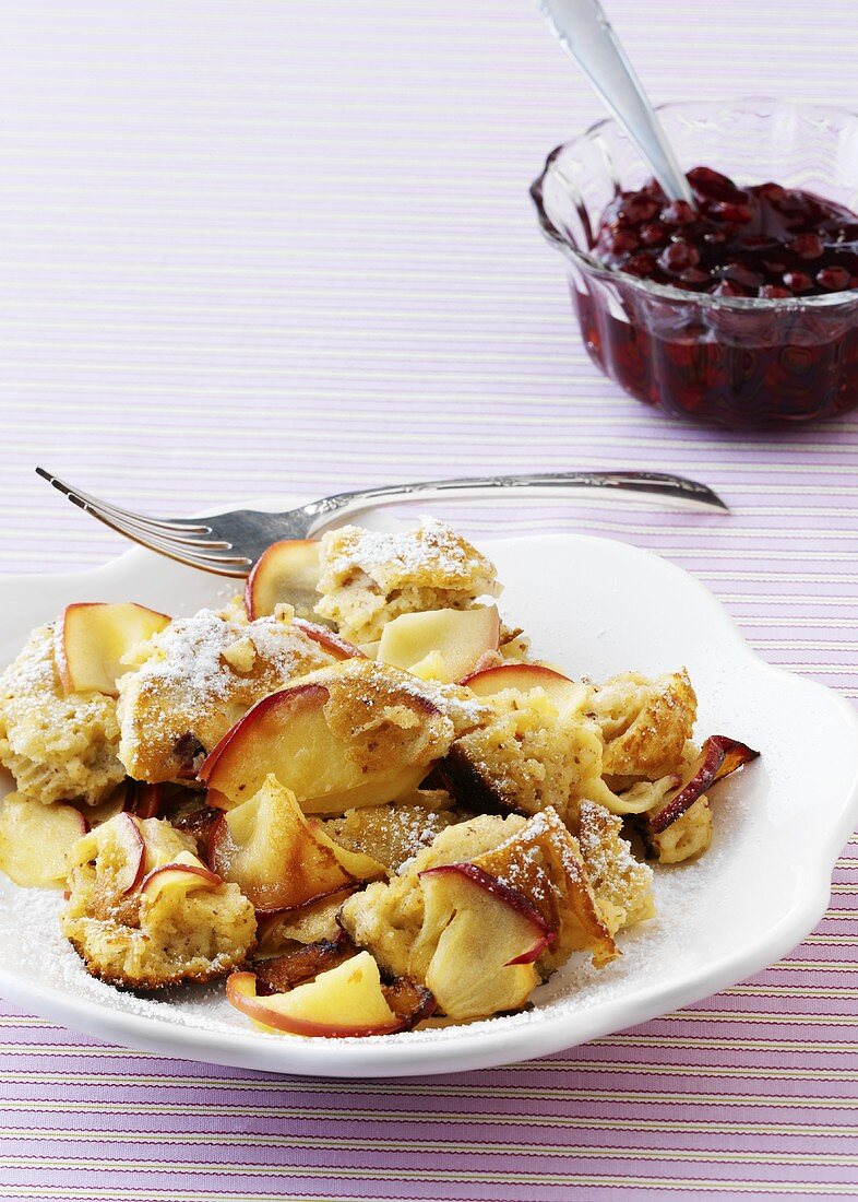 Scrambled pancake with apple and nuts