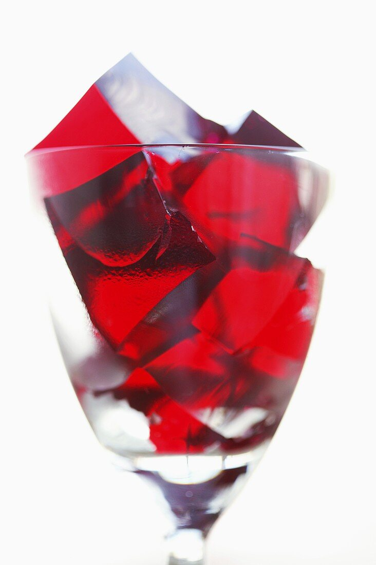 Cubes of raspberry jelly in a glass