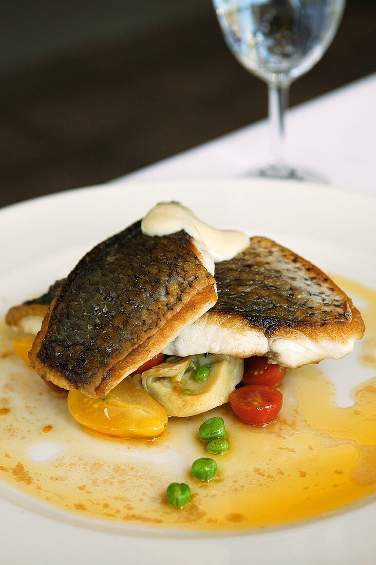 Snapper fillet with cherry tomatoes and peas