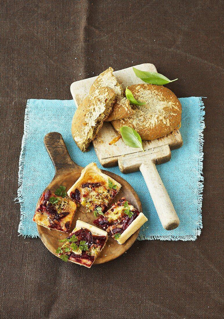 Pesto flatbread and pieces of beetroot tart