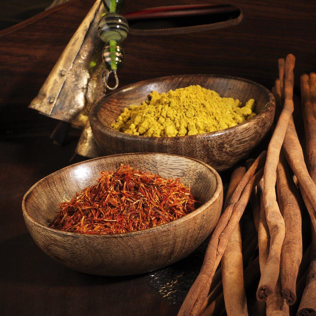 Safflower (saffron substitute), curry powder and cinnamon sticks