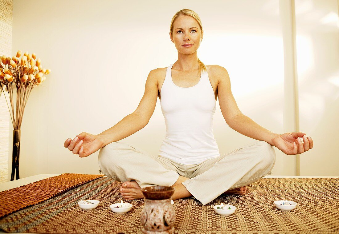 Woman in yoga position in meditation area