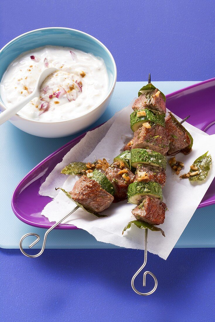 Lamb and courgette kebabs with onion and yoghurt sauce