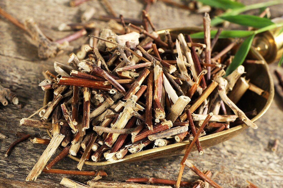 Dried honeysuckle stem in scoop