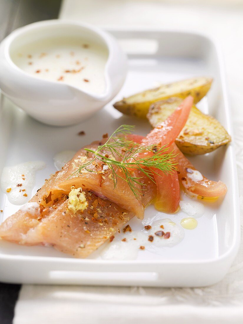 Marinated huchen (Danube salmon) with elderflower buttermilk foam