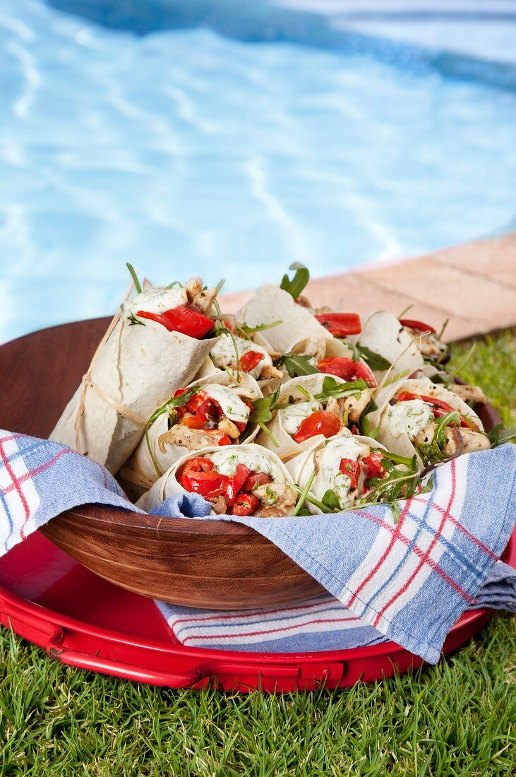 Wraps filled with Mojito chicken, coriander & lemon aioli & red pepper