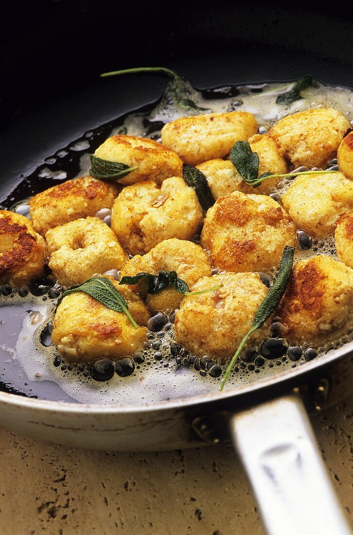 Ricotta gnocchi with sage in frying pan