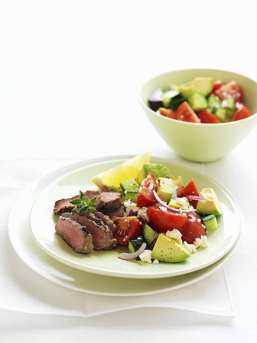 Lamb with Greek avocado salad