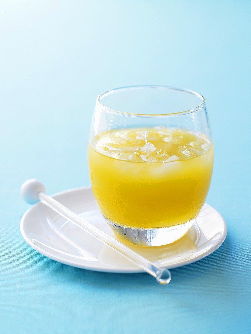 Mango gimlet in a glass