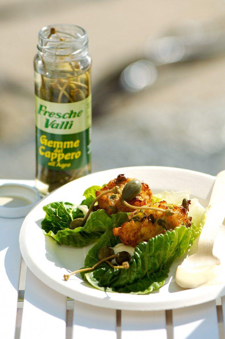 Stockfish cakes in lettuce leaves