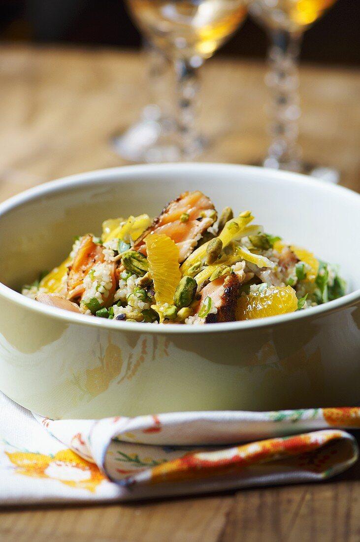 Bulgur salad with fried salmon and mandarin orange segments