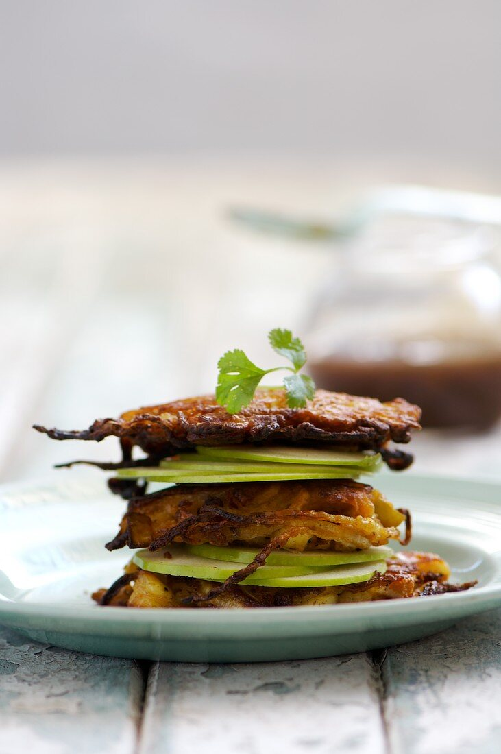 Apple, Halloumi and onion patties, garnished with apple slices