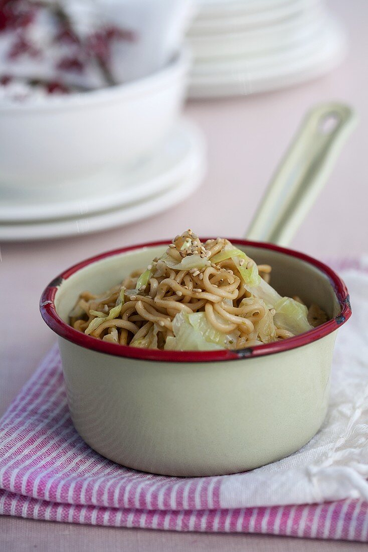 Pasta with white cabbage, sesame and cinnamon