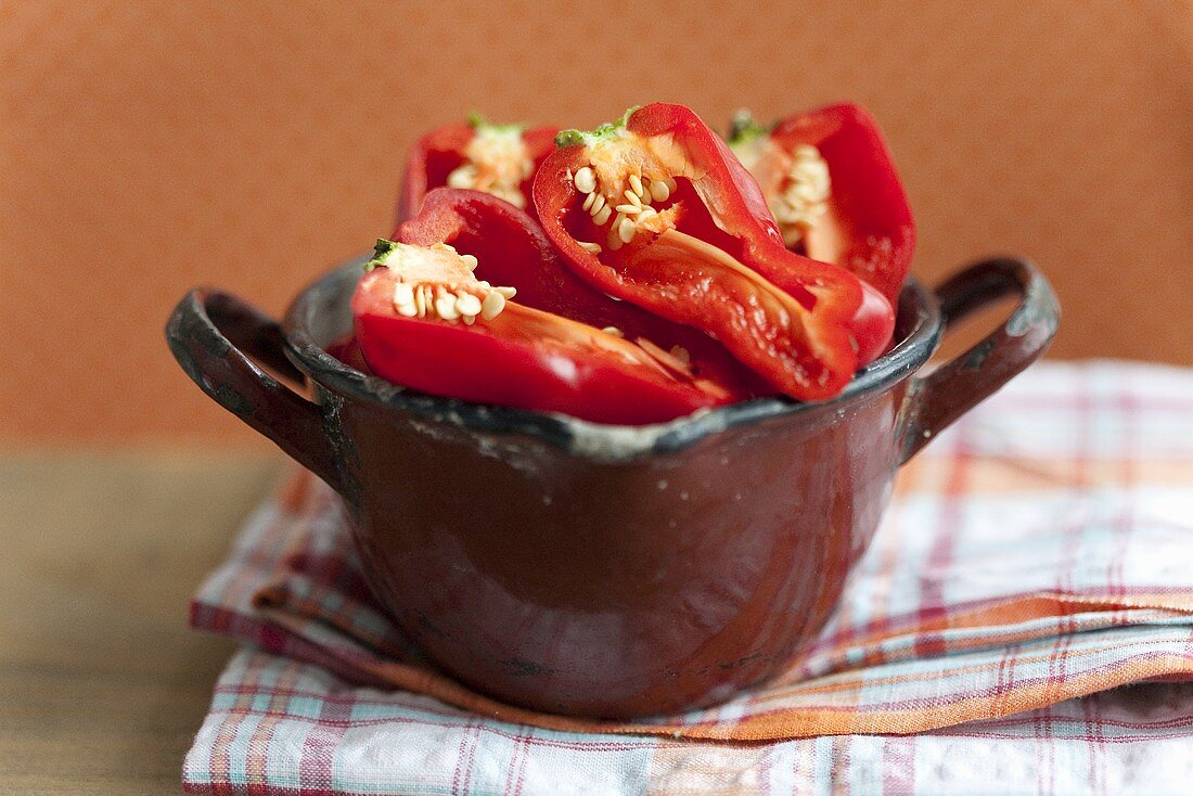 Red peppers in an enamel pot