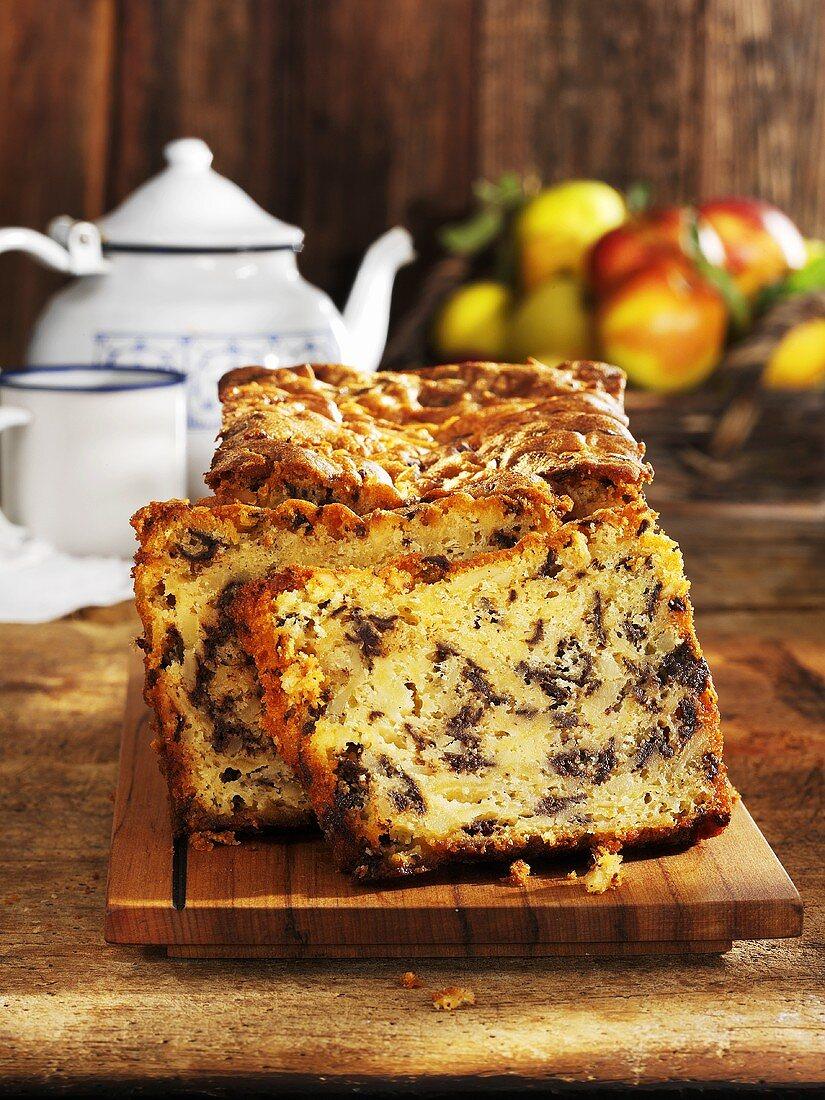 Apple chocolate cake, partly sliced