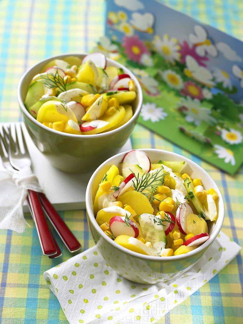 Potato salad with cucumber, sweetcorn and radishes