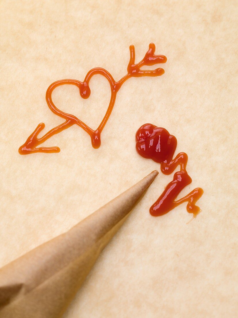 Heart with arrow, piping bag and ketchup