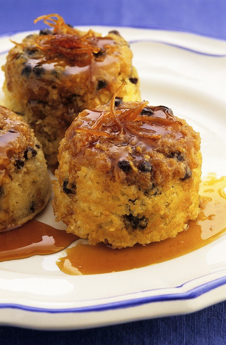 Spotted Dick (steamed currant pudding) with maple syrup (UK)