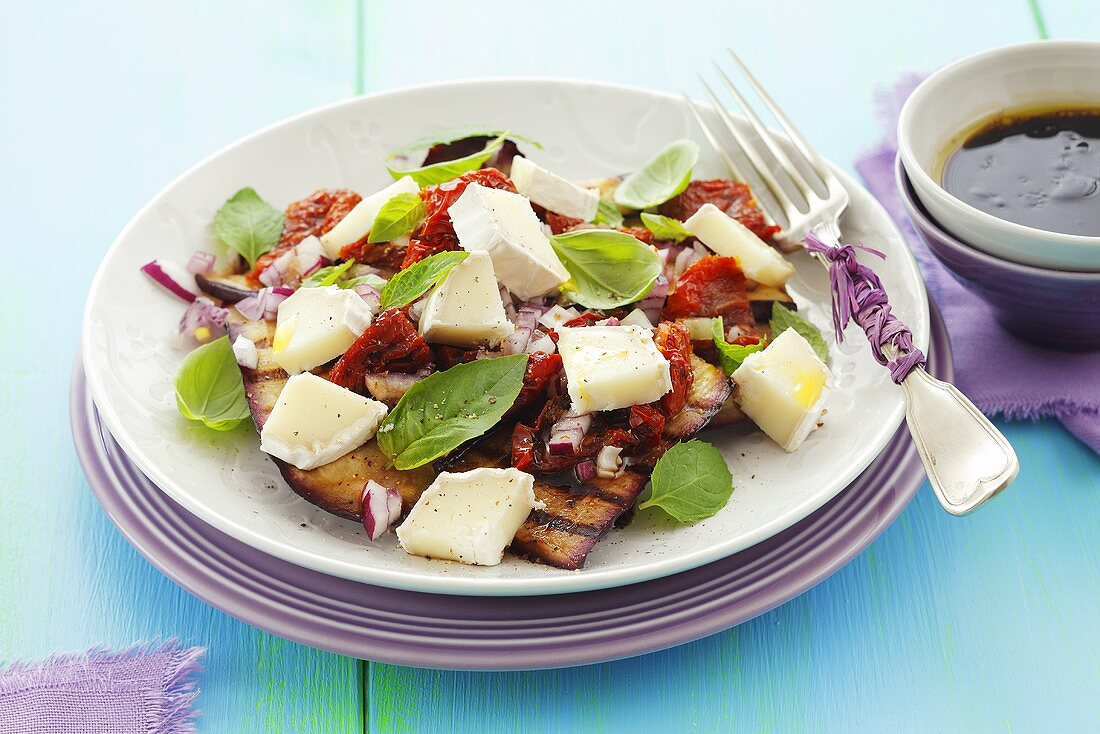 Grilled aubergine salad with dried tomatoes and goat's cheese